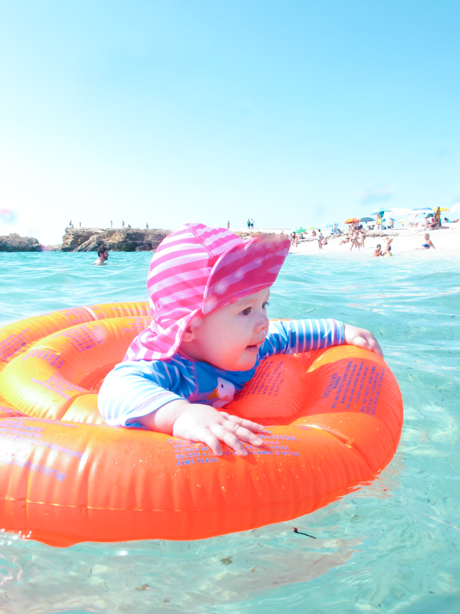 Baby swimming in the sea